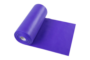 a roll of lilac ribbon for stretching, fitness or yoga, on a white background, isolate © aneduard