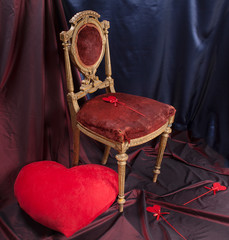 a large red heart and small hearts, an antique chair. Valentine's Day.