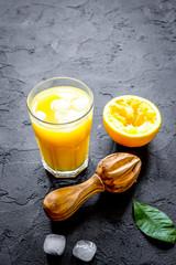 freshly squeezed orange juice on dark background