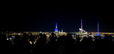 People photograph the Manhattan's skyline from the Top Of The Rock Observatory at night.