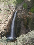 Small waterfall at the feet of a bridge in a canyon in the mountains of Ronda, Spain