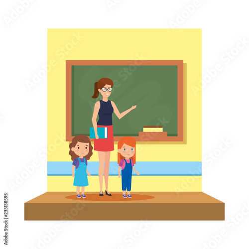 female teacher with girls in the classroom