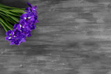 Bouquet of flowers iris lies on a wooden gray table
