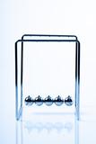 Newtons Cradle balancing balls, business concept in studio - 235152596