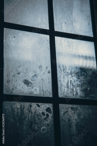 wooden window with mist - cold atmosphere - 235164170