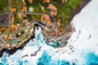 Aerial view of the village of Porto Moniz with lava-rock pool, Madeira Island, Portugal - 235180969