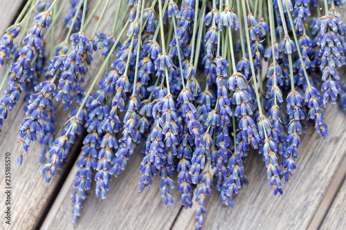 Lavender bouquet on a wooden table, top view