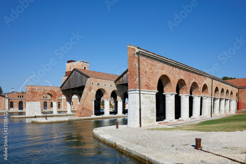 Venetian Arsenal with docks and arcade in a sunny day in Venice, Italy