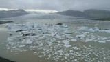 Aerial flyover of a glacier lagoon in Iceland - 235200909