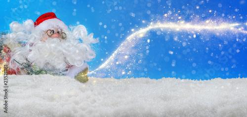Leinwanddruck Bild Santa Claus in the snow with stardust, Banner