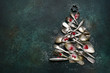 Leinwanddruck Bild - Abstract christmas tree made from vintage cutlery.Top view with copy space.