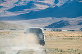 Driving a 4WD across country road in Tibet, China