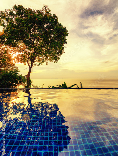 Leinwandbild Motiv Beautiful colorful landscape, infinity pool in the sea at sunset