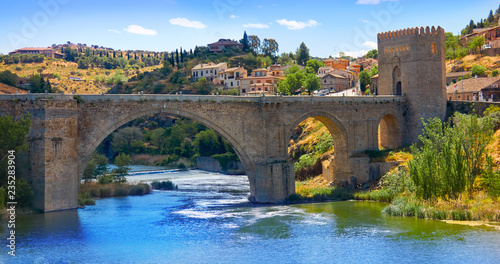 Leinwanddruck Bild Tajo river in toledo city bridge of Spain