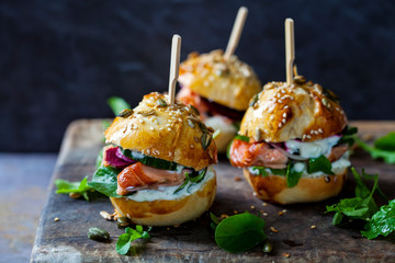 Brioche buns with hot smoked salmon, beetroot, salad and yogurt dressing