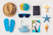 Travel holiday vacation concept with beach and travel items organized on white background