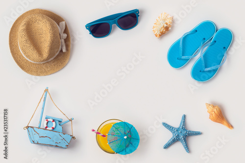 Travel holiday vacation concept with beach and travel items organized on white background - 235317158