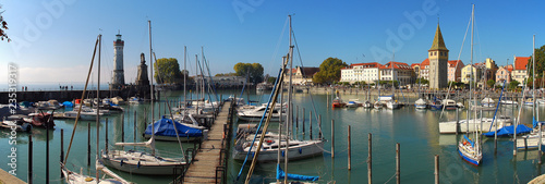 Harbour entrance of Lindau,  Lake Constance (German: Bodensee) with the new lighthouse and the Bavarian Lion