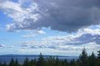 Fundy National Park, New Brunswick, Canada: Bright blue sky with fluffy white clouds over the Bay of Fundy at high tide.