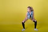 young attractive girl dancing twerk, shaking ass in shorts. copy-space