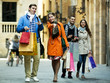 Group of young tourists with purchases