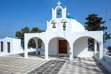 Beautiful orthodox church on Santorini in Greece. Traditional small white church on Santorini. - 235377573