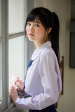 Portrait of thai high school student uniform teen beautiful girl happy and relax - 235385933