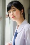 Portrait of thai high school student uniform teen beautiful girl happy and relax - 235385976