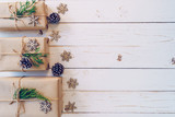 Homemade wrapped christmas gift box presents on a wood table background with space. - 235388706