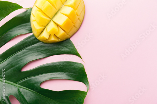 Monstera green leaves with mango on pink - 235427777