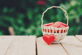 Red heart in basket on wooden table for valentine day and love concept with copy space. - 235446545