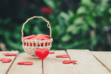 Red heart in basket on wooden table for valentine day and love concept with copy space. - 235446575
