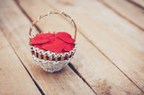 Red heart in basket on wooden table for valentine day and love concept with copy space. - 235446589