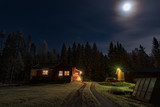 full moon shining over a little red cabin - 235447912