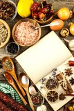 Cookbook and spice on a wooden table. Food preparation. An old book in the kitchen. Recipes for food - 235466721