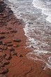 Prince Edward Island, Canada: Red sandstone on a beach on the north shore of Prince Edward Island, in the Gulf of St. Lawrence.