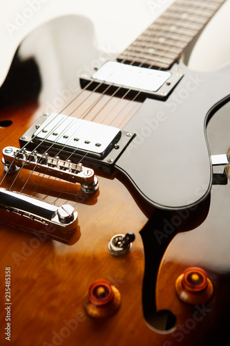 CLOSE UP OF ELECTRIC SEMI ACOUSTIC GUITAR - 235485358