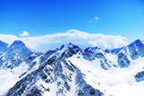 snow mountain landscape against the blue sky with clouds. Elbrus. Russia. North Caucasus