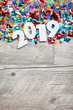 NYE2019: Wooden 2019 Year Number On Confetti Background