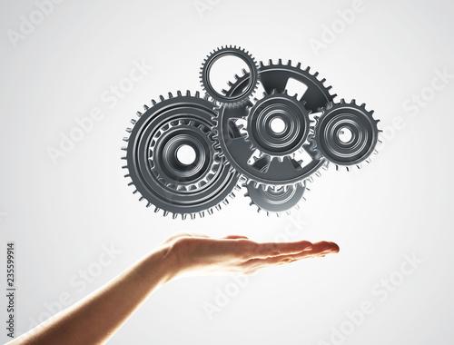 Leinwandbild Motiv Concept of teamwork and cooperation presented with working gear engine