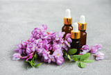 Essential oils and pink acacia flowers