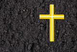 Cross or crucifix made of ash, dust or sand. Ash Wednesday. Lent. Christian religion.