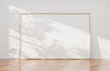 Large horizontal frame leaning on a white wall 3D rendering - 235619310
