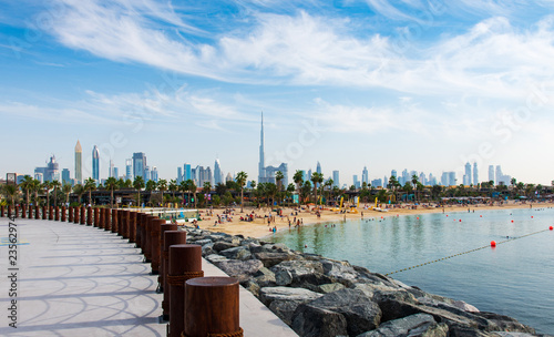 Leinwandbild Motiv Panoramic view of Dubai downtown from La Mer beach