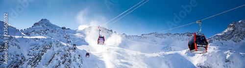 Leinwandbild Motiv Stunning winter panorama in Tonale ski resort. View of Italian Alps from Adamelo Glacier, Italia, Europe.