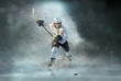 Leinwandbild Motiv ice hockey Players in dynamic action in a professional