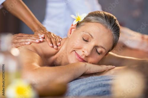 Leinwanddruck Bild Woman receiving massage at spa