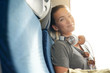 Young woman relaxing on train
