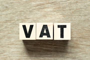 Letter block in word VAT (value added tax) on wood background