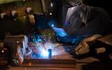 Welder working in workshop factory - 235657547